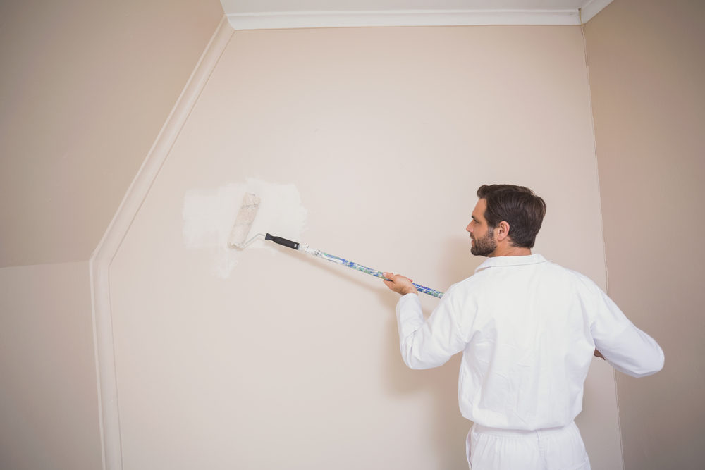 painter-painting-the-walls-white-in-a-new-house