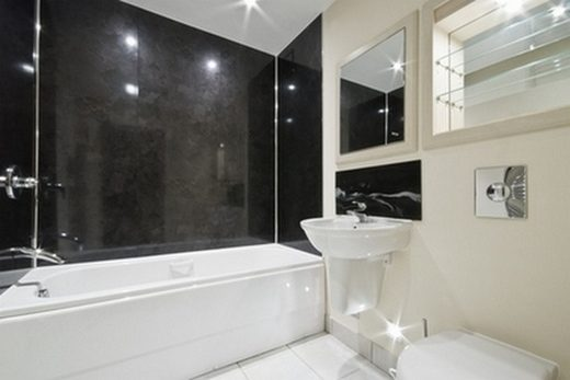 contemporary-bathroom-with-natural-black-stone-tiles