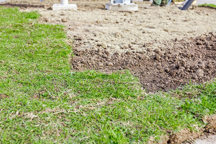 partially-placed-sod-for-new-lawn-unrolling-grass