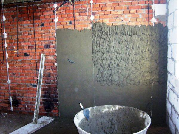 Наложение цементной штукатурки