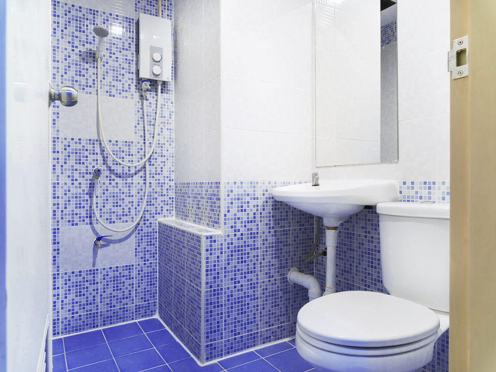 old-style-washroom-with-small-blue-ceramic-color-decoration-toilet-washbasin-and-mirror