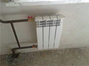 vysota_radiatora_ot_pola_1_06104243-300x225-7811584