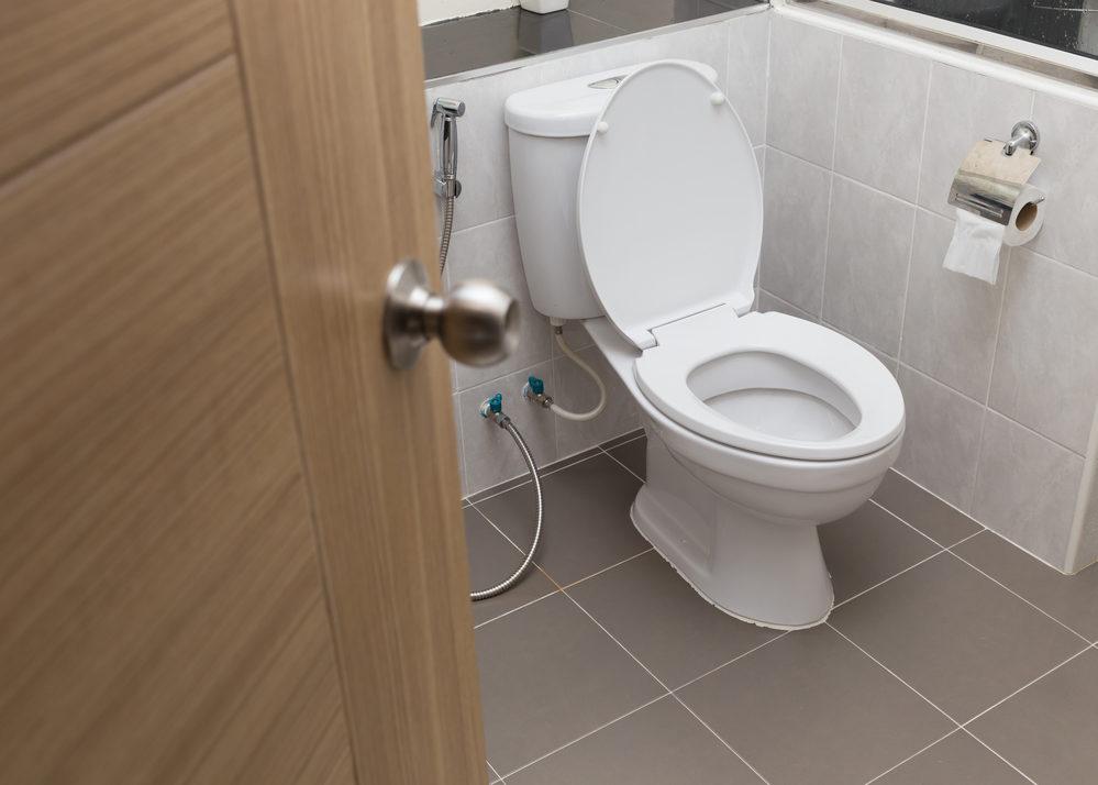 white-flush-toilet-in-modern-bathroom-interior