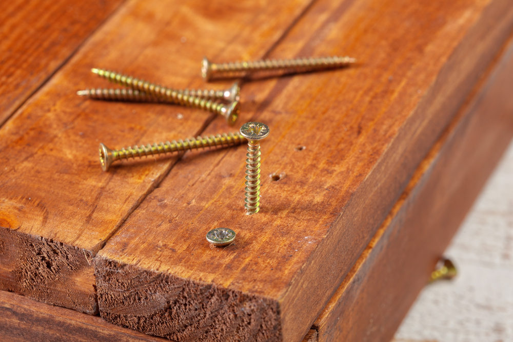 screws-on-a-wooden-table